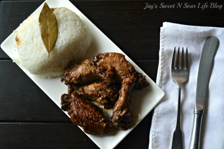 Filipino Chicken Adobo Plated. Try my family's secret recipe for Filipino Chicken Adobo, this popular Filipino dish has been passed down from generation to generation. Simmered in a savory sauce with soy sauce, bay leaves, and other spices low and slow, so the meat falls off the bone.
