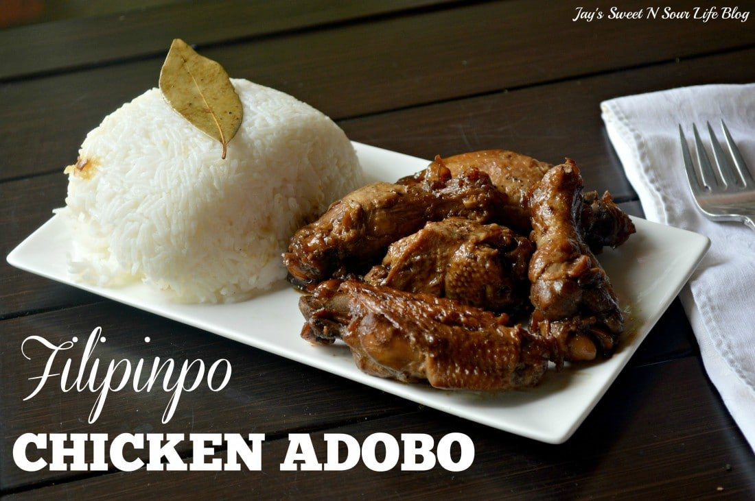 Filipino Chicken Adobo Closeup. Try my family's secret recipe for Filipino Chicken Adobo, this popular Filipino dish has been passed down from generation to generation. Simmered in a savory sauce with soy sauce, bay leaves, and other spices low and slow, so the meat falls off the bone.