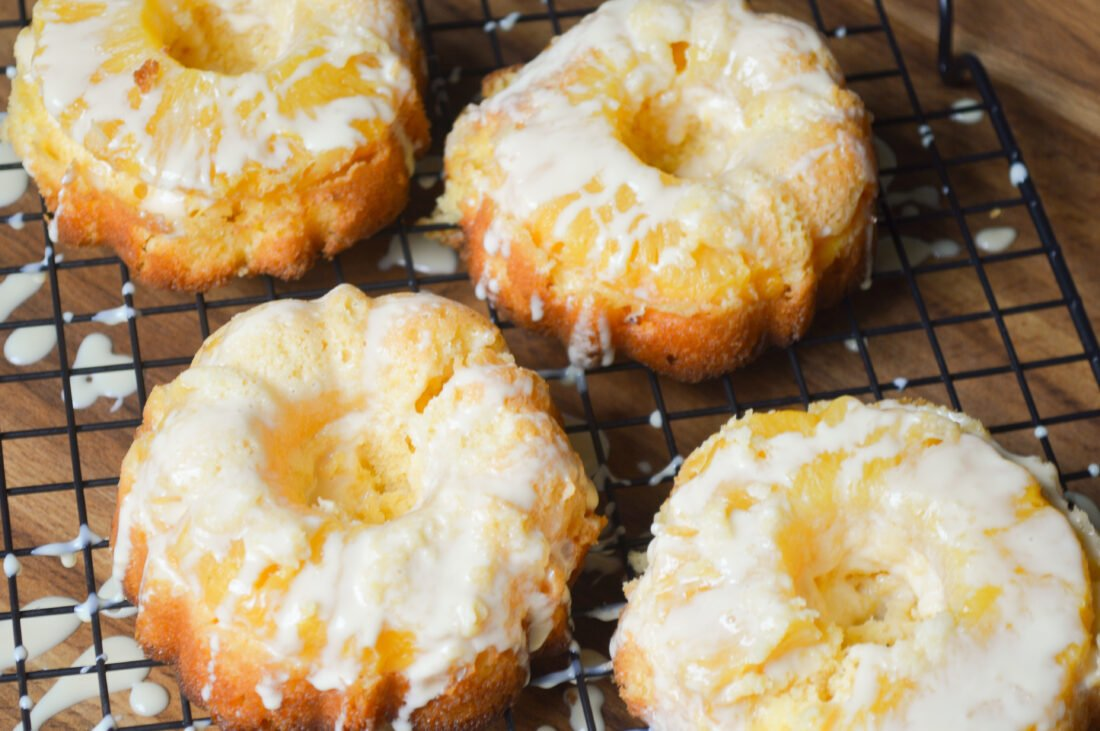 Serve these easy-to-make mini Pineapple Upside Down Cakes at holiday parties, or family get-togethers. This recipe uses a boxed cake mix for a quick and easy dessert recipe. These mini pineapple upside-down cakes are perfect for any time of the year!
