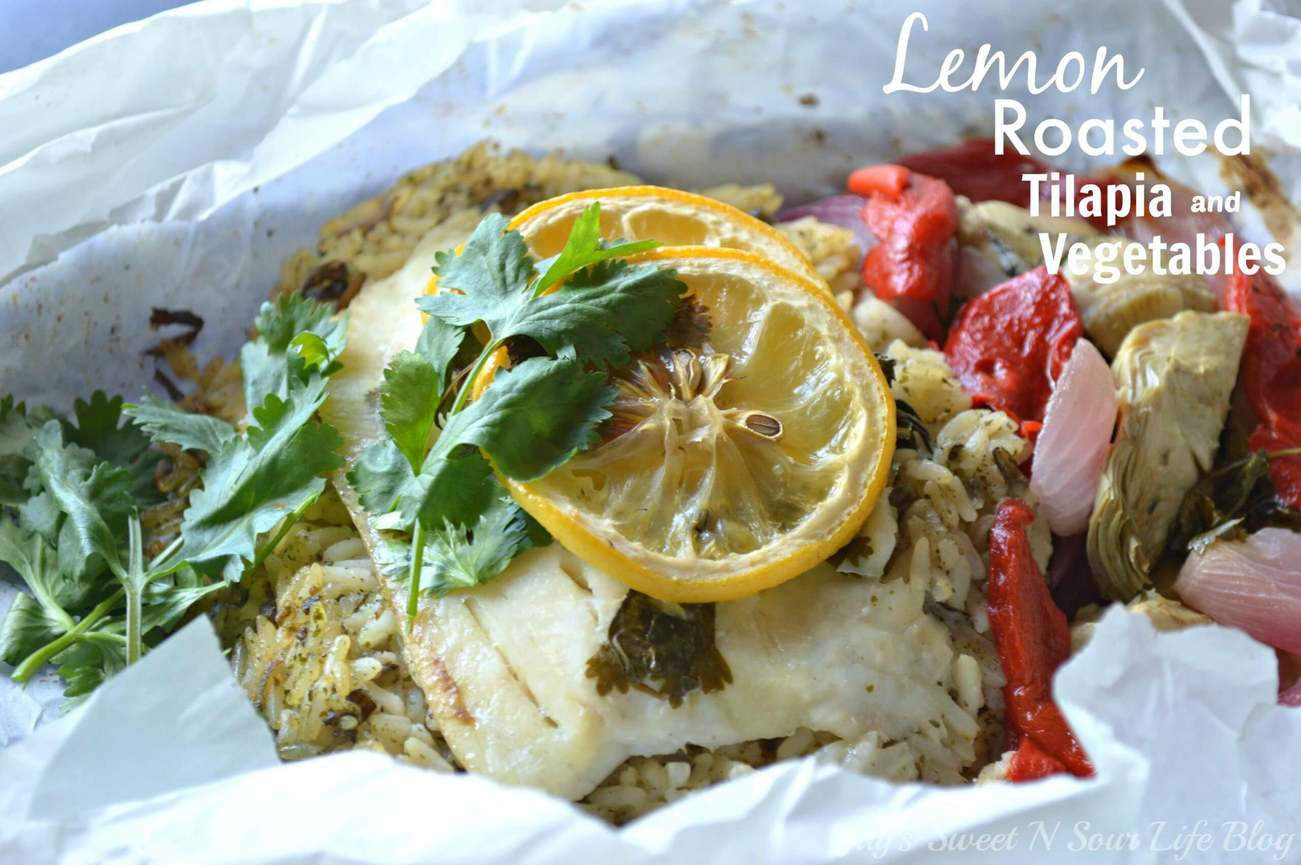 Lemon Roasted Tilapia and Vegetables Recipe. Dinner for two has never been so easy and delicious. This Fresh Lemon Roasted Tilapia and Vegetables are full of fresh flavor and spices.