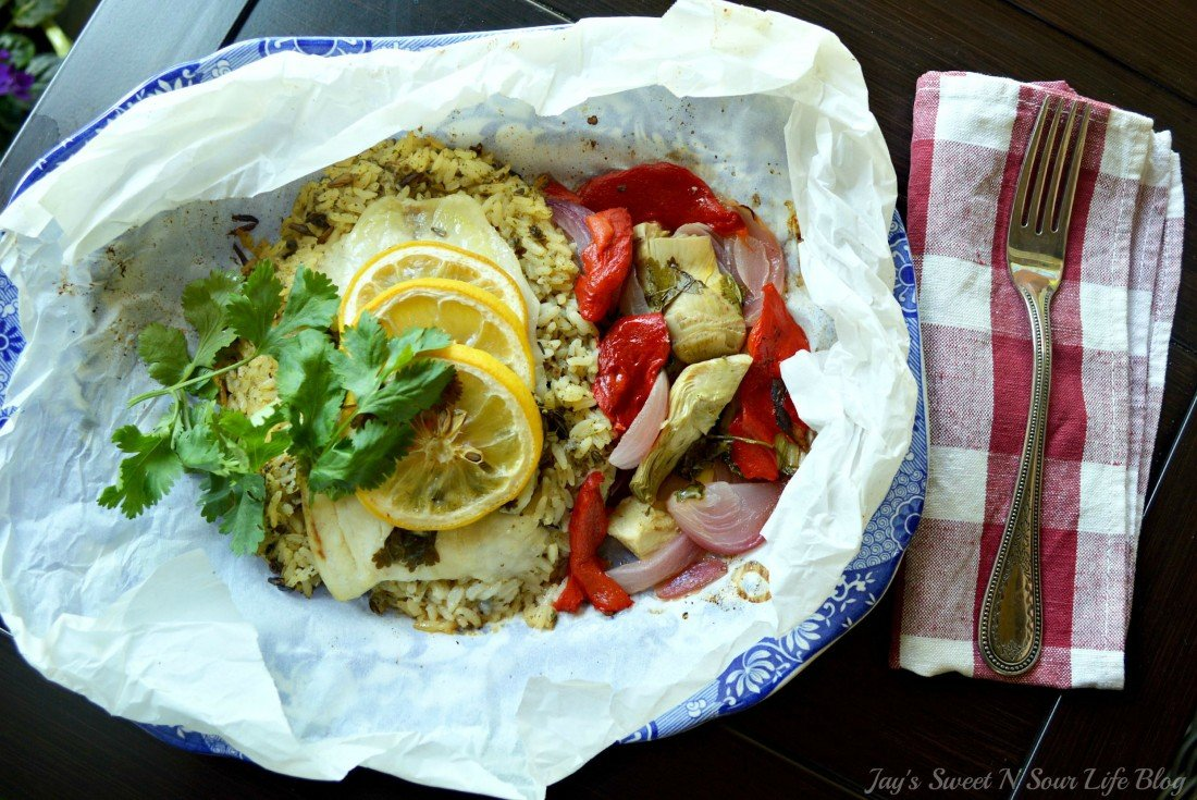 Lemon Roasted Tilapia and Vegetables Plated. Dinner for two has never been so easy and delicious. This Fresh Lemon Roasted Tilapia and Vegetables are full of fresh flavor and spices.