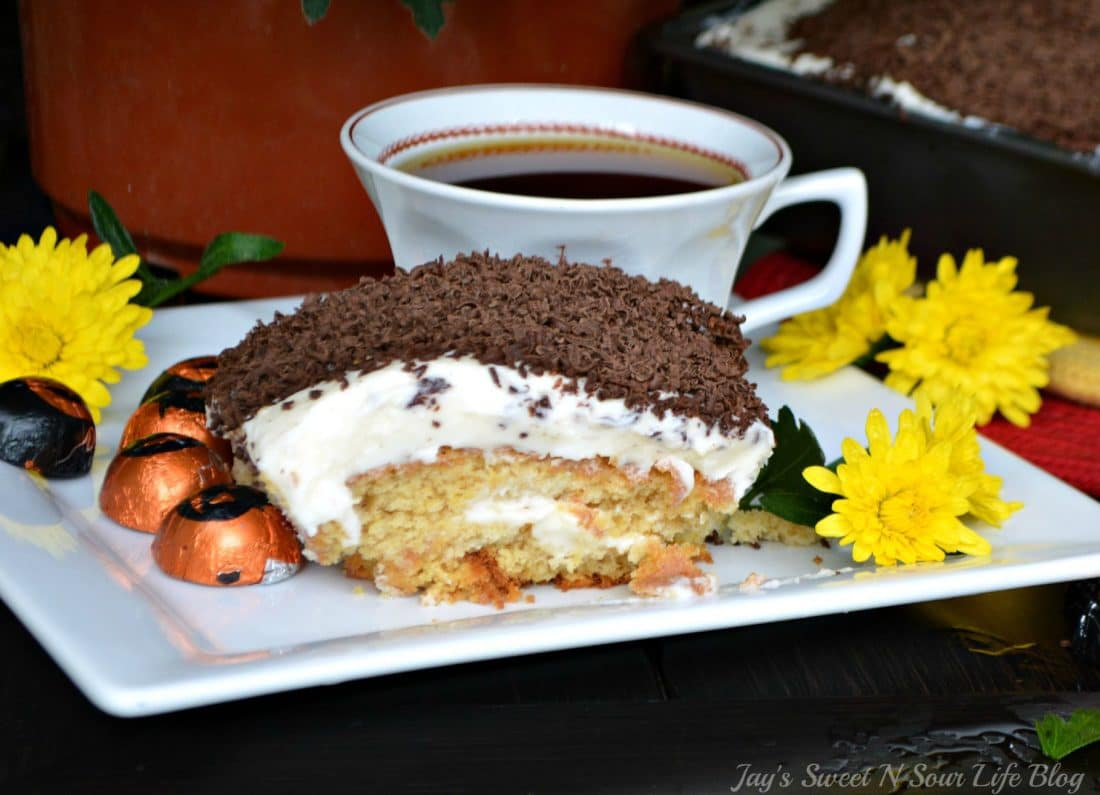 Pumpkin Tiramisu on plate. Fall means pumpkin and whats fall without pumpkin flavored desserts. Enjoy a slice of this amazingly easy to make Pumpkin Tiramisu with your morning cup of coffee.