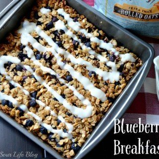 A quick and easy Blueberry Oat Breakfast Bars recipe that your kids will go crazy for. A wonderful on-the-go breakfast option that's packed with fresh blueberries, organic rolls oats, baked, and then drizzled with a tangy yogurt glaze.