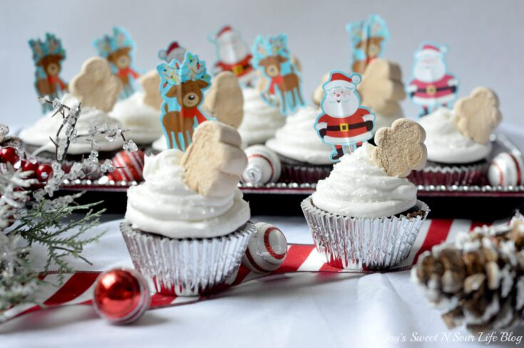 A quick and easy holiday dessert recipe, these Marshmallow Christmas Cupcakes are made with boxed cake mix for a hassle-free cupcake recipe. Top these moist chocolate cupcakes with marshmallow frosting and fun holiday-themed candy.