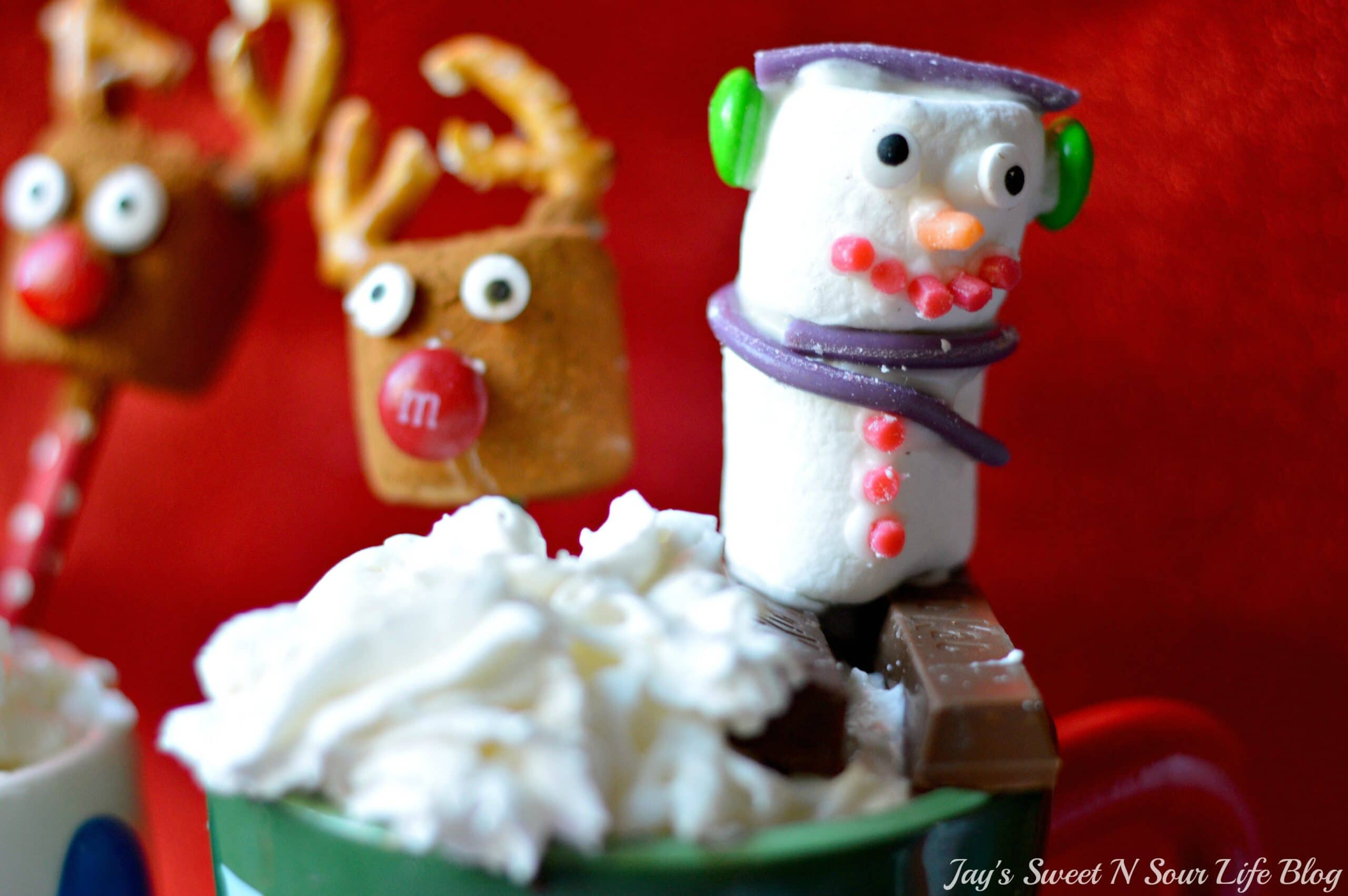 Slow Cooker Eggnog Hot Chocolate Snowman Marshmallow. This decadent Eggnog Hot Chocolate is the perfect holiday drink for Christmas Parties. Made in the slow cooker, this eggnog infused hot chocolate is smooth, creamy, chocolatey, and easy to make.