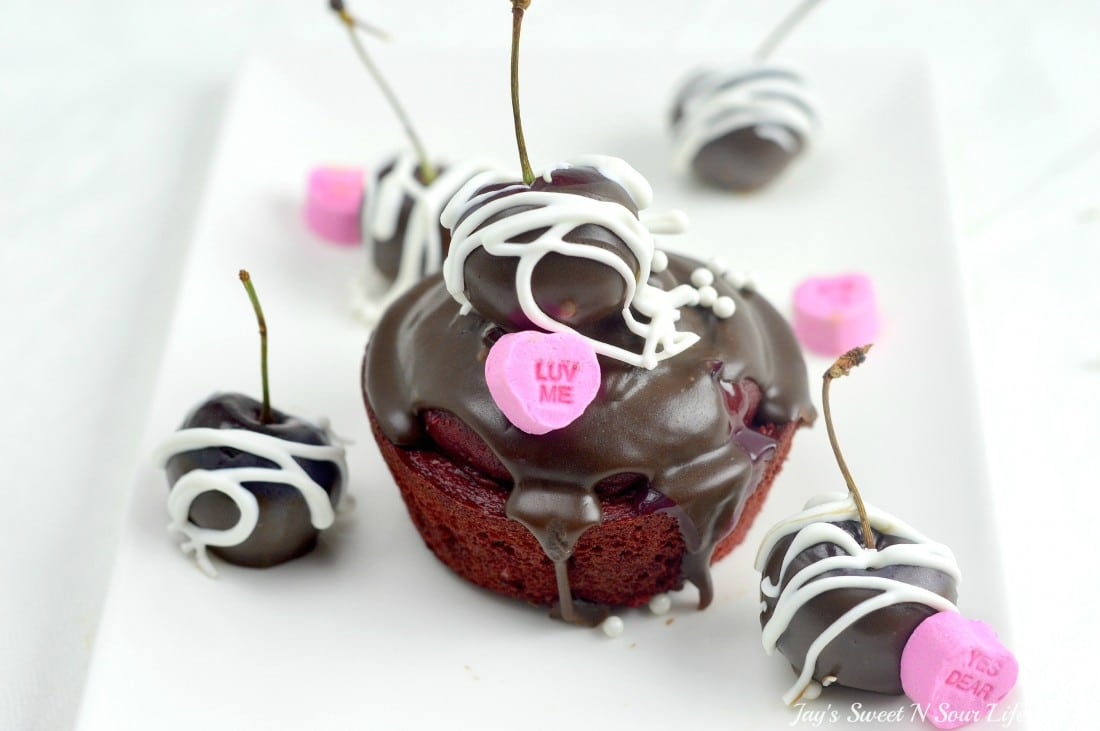 Cherry Valentines Day Cupcake Closeup.A Red Velvet Cupcake filled with a delicious from scratch Cherry Sauce. Topped with Chocolate Ganache and chocolate dipped cherries.