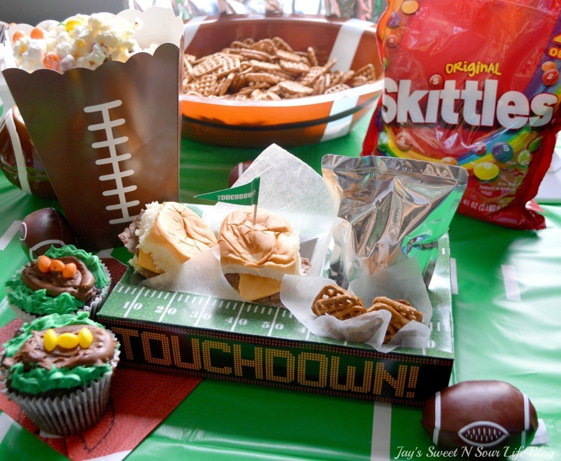 Game Day Skittles Inspired Snacks Table. Game Day Skittles Inspired Snacks that all of your friends and family can enjoy! Recipes include skittles popcorn, football cupcakes and more!