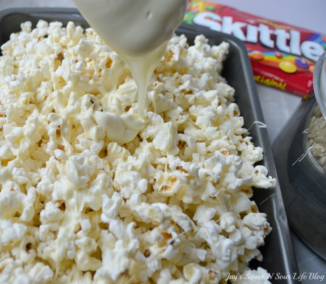 Game Day Skittles Inspired Snacks popcorn step 6. Game Day Skittles Inspired Snacks that all of your friends and family can enjoy! Recipes include skittles popcorn, football cupcakes and more!
