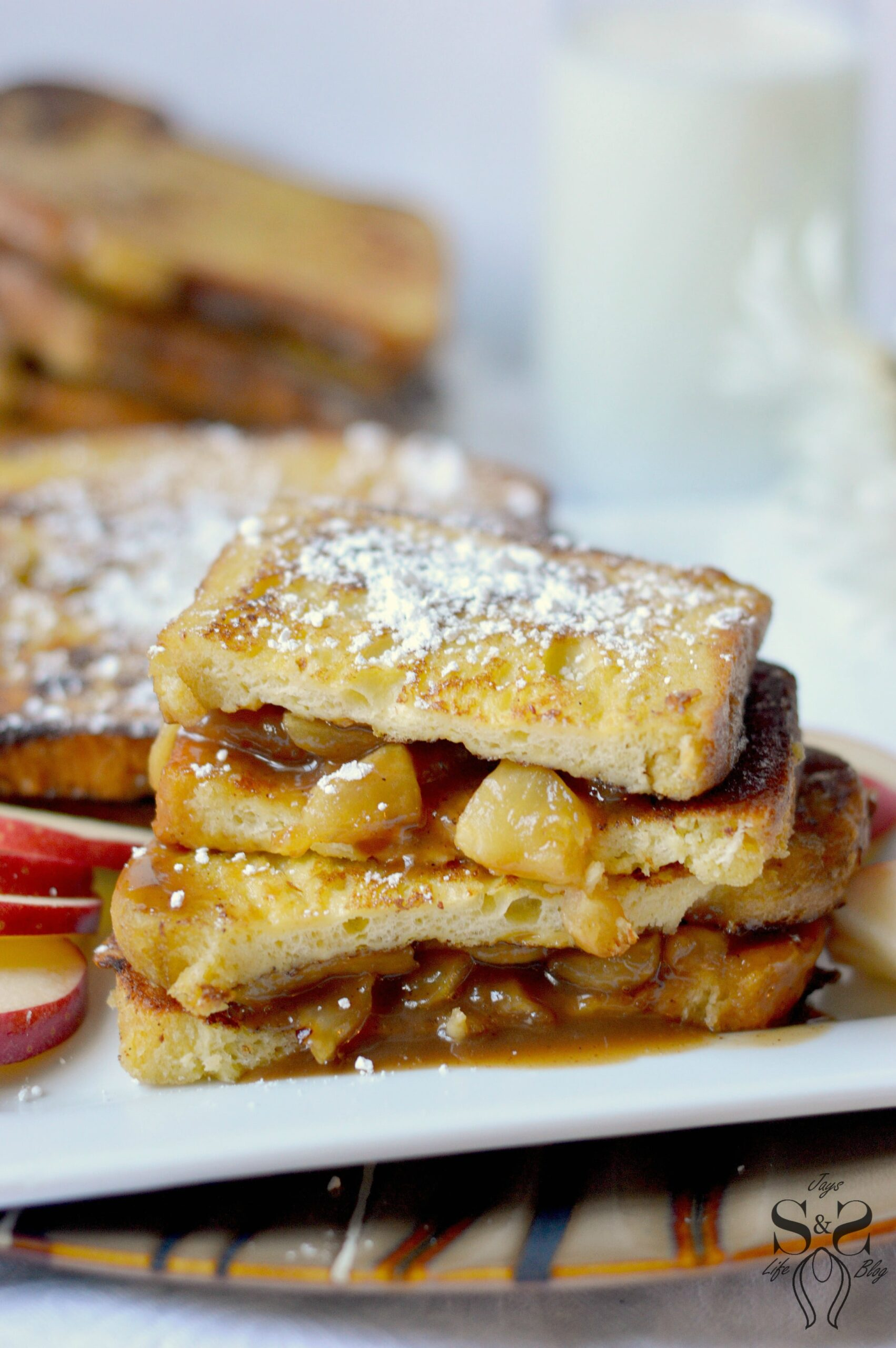 The decadent Caramel Apple Stuffed French Toast has a cooked caramel apple filling stuffed between challah French toast. This easy-to-make breakfast recipe is perfect for brunch, Saturday morning breakfast, or brinner.