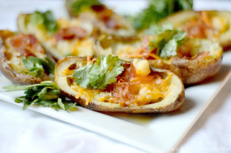 Easy Loaded Garlic Potato Skins that are perfect for game day snacks. Extremely easy to make and perfect for make-ahead game day snacks, your team will love these loaded potato skins.