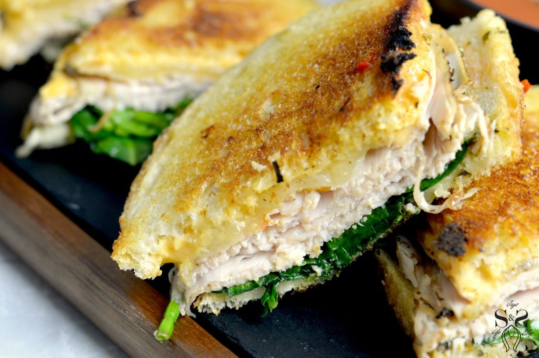 Turkey Pesto Grilled Cheese Sandwic closeup. If you are looking for that restaurantquality bistro sandwich, look no further. Bring the bistro home when you try my Turkey Pesto Grilled Cheese.
