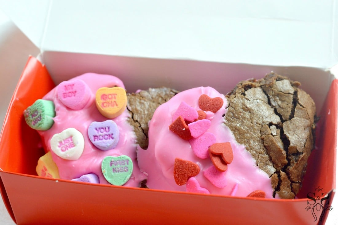 Valentine's Day Fudgy Brownies inside box. A from-scratch Valentine's Day Fudgy Brownie recipe, stuffed with butterscotch chips. Dipped in chocolate and then topped with candy hearts and sprinkles.