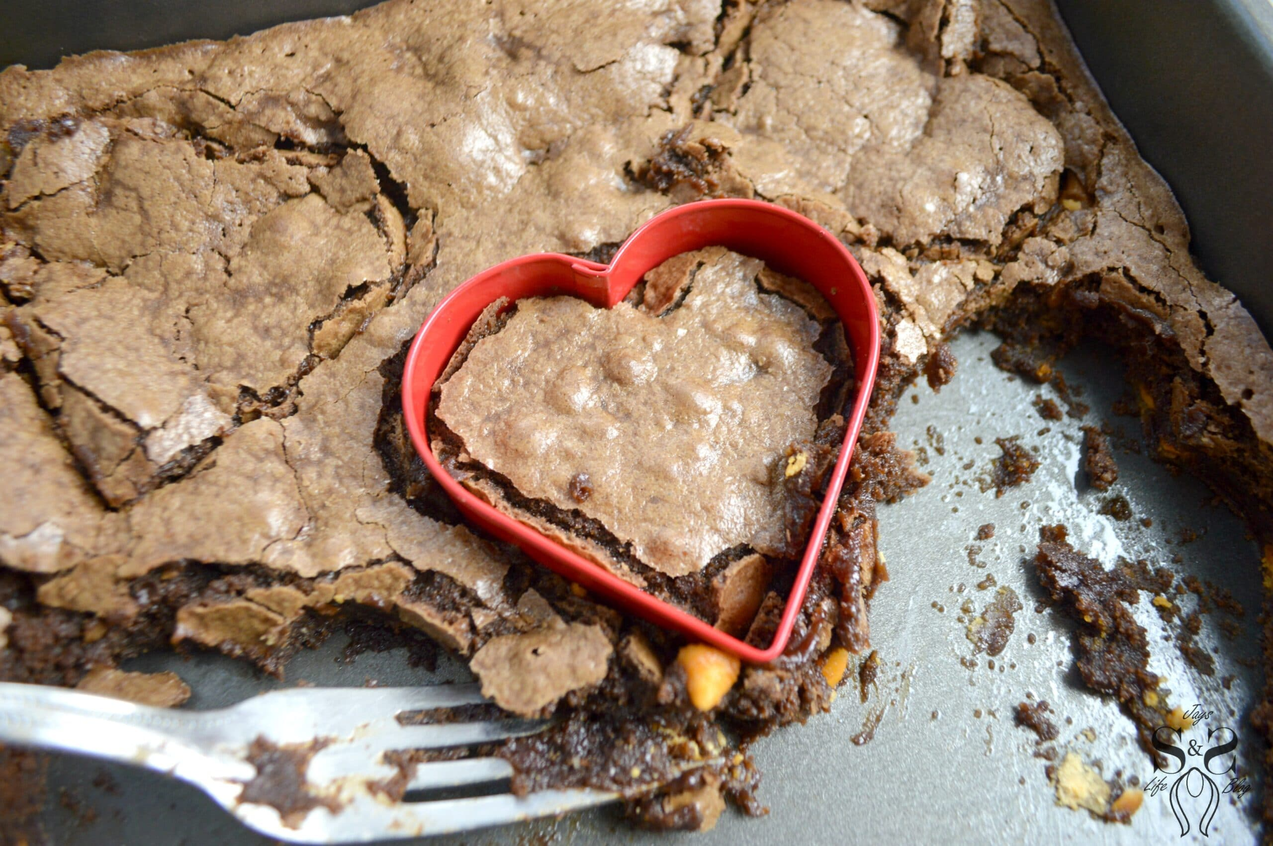 Valentine's Day Fudgy Brownies IStep 12. A from-scratch Valentine's Day Fudgy Brownie recipe, stuffed with butterscotch chips. Dipped in chocolate and then topped with candy hearts and sprinkles.