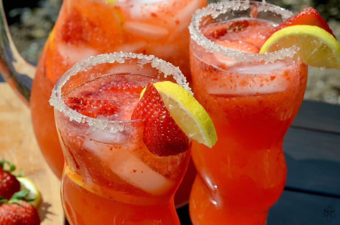 Strawberry Lemonade Closeup. Stop buying premade! Enjoy a freshly squeezed cup of Strawberry Lemonade on a warm sunny day, it's the perfect deliciously refreshing way to cool off. Everything tastes better homemade!