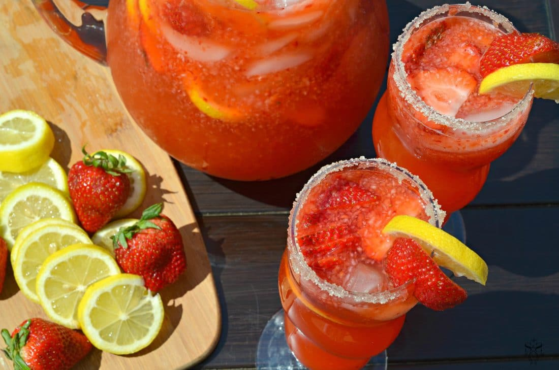 Strawberry Lemonade in glasses. Stop buying premade! Enjoy a freshly squeezed cup of Strawberry Lemonade on a warm sunny day, it's the perfect deliciously refreshing way to cool off. Everything tastes better homemade!