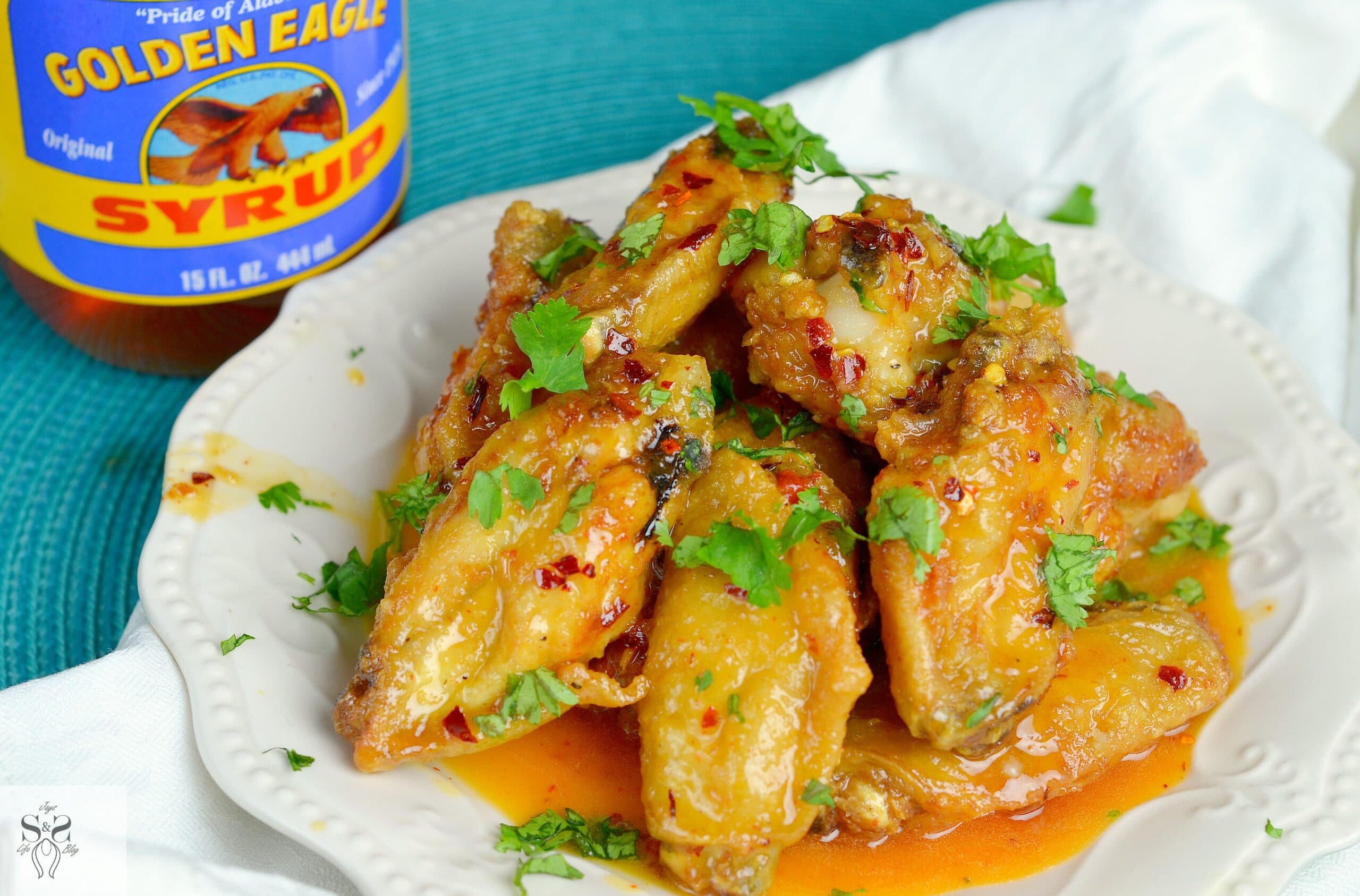 Spicy Buttery Chicken Wings Wideshot plate. Perfect for any night, these Spicy Buttery Chicken Wings are so easy to make and oh so delicious.