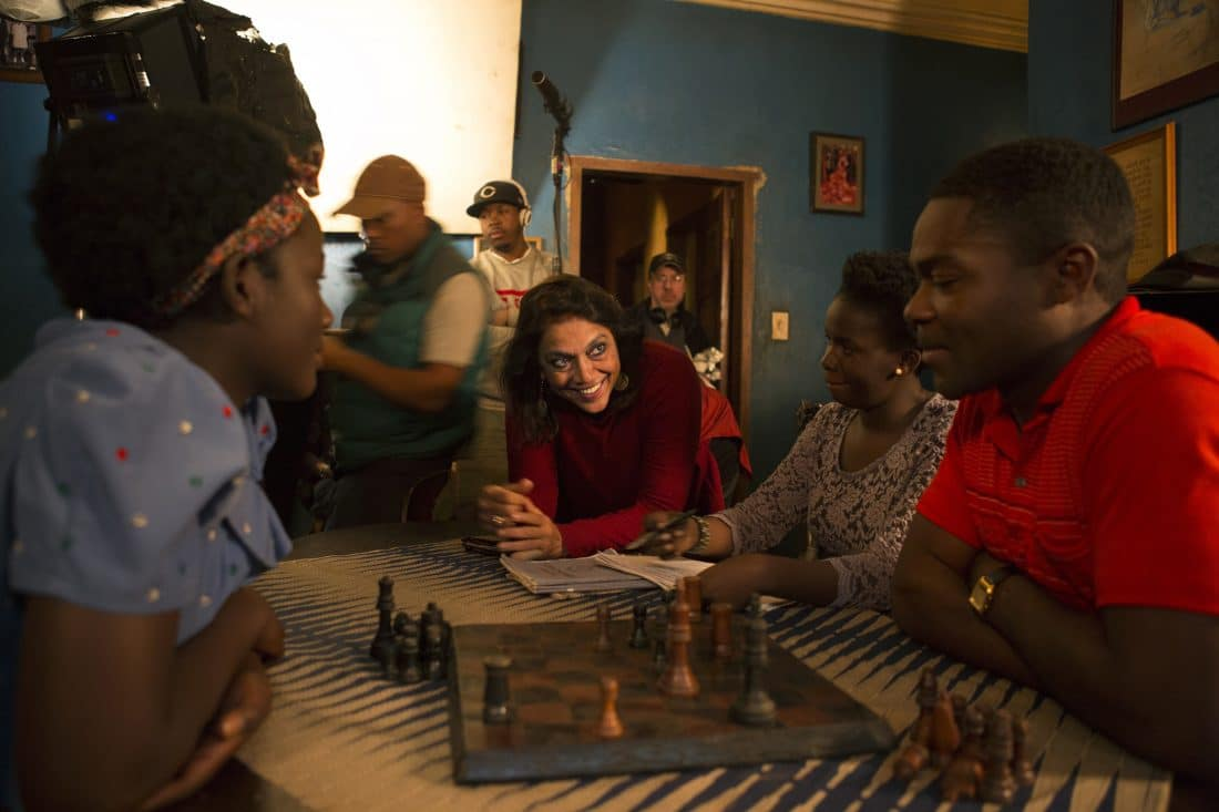 Director Mira Nair on the set of Disney's QUEEN OF KATWE iwith David Oyelowo,Madina Nalwanga and Esther Lutaaya. The vibrant true story of a young girl from the streets of rural Uganda whose world changes when she is introduced to the game of chess, the film also stars Oscar (TM) winner Lupita Nyong'o.
