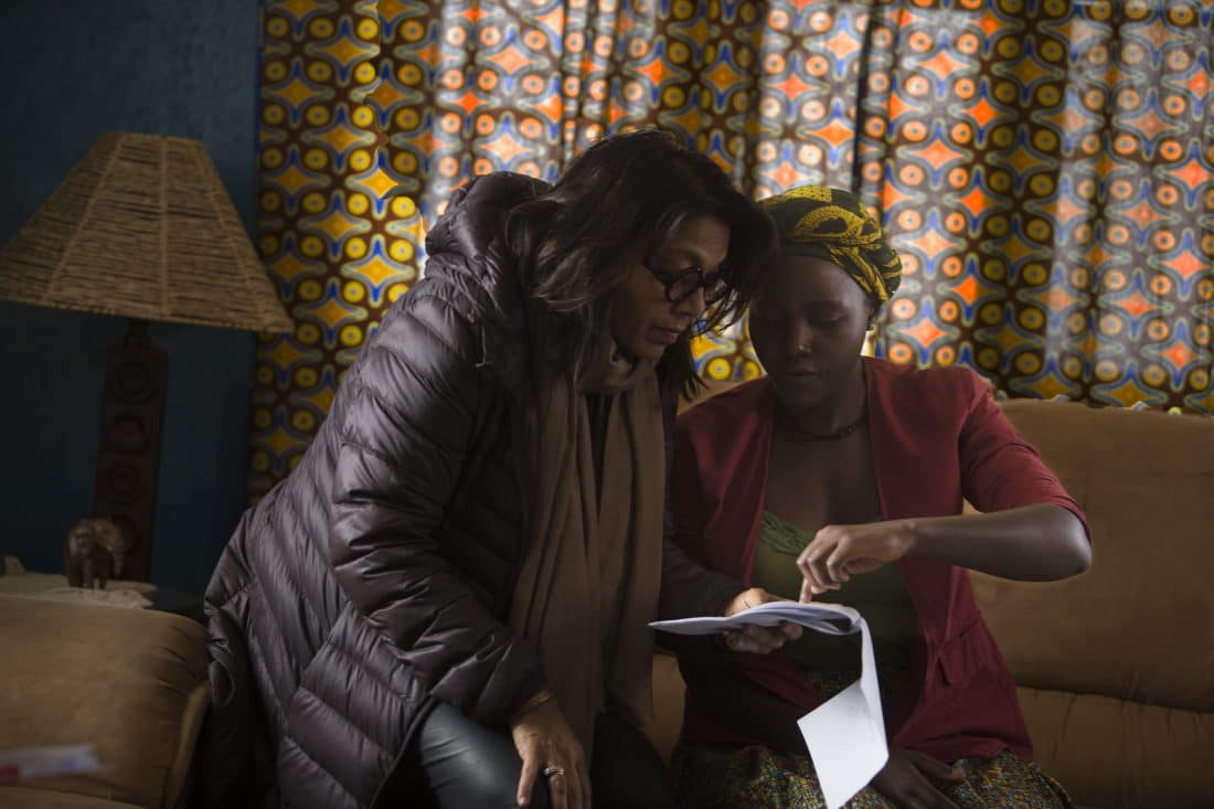 Director Mira Nair on the set of Disney's QUEEN OF KATWE with Lupita Nyong'o The film is based on a true story of a young girl from the streets of rural Uganda whose world changes when she is introduced to the game of chess, the film also star Oscar (TM) winner Lupita Nyong'o.