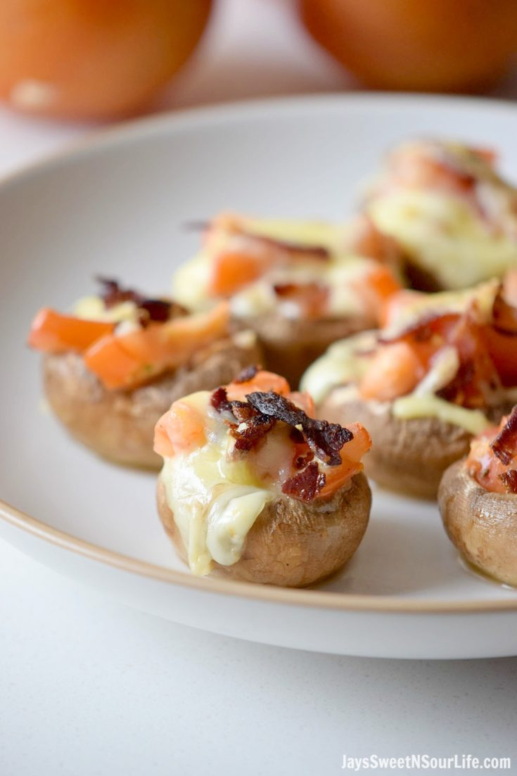 These easy-to-make Caprese Stuffed Mushrooms are the perfect make-ahead snack or vegetarian dish. A garlic butter brushed mushroom stuffed with mozzarella, tomatoes and topped with bacon.