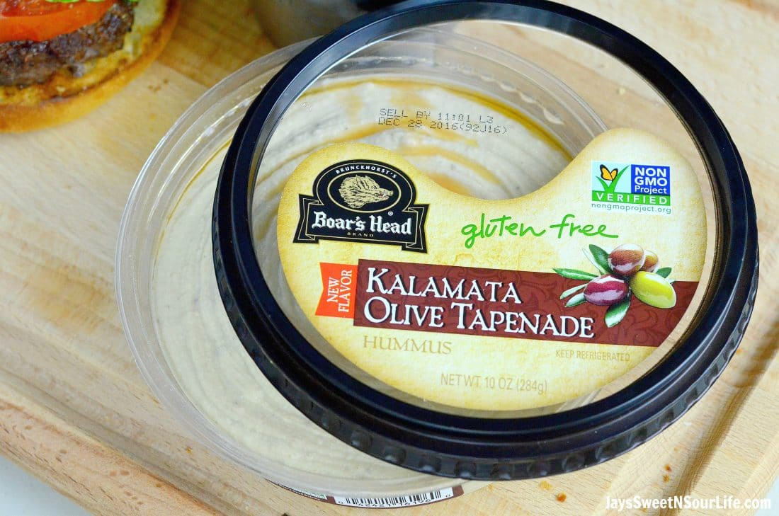 Boars Head Hummus Kalmata Olive Tapenade closeup. Deck the halls and your home with the smell of delicious fresh made Mediterranean Bison Burger and fries using Boar's Hummus as a spread.