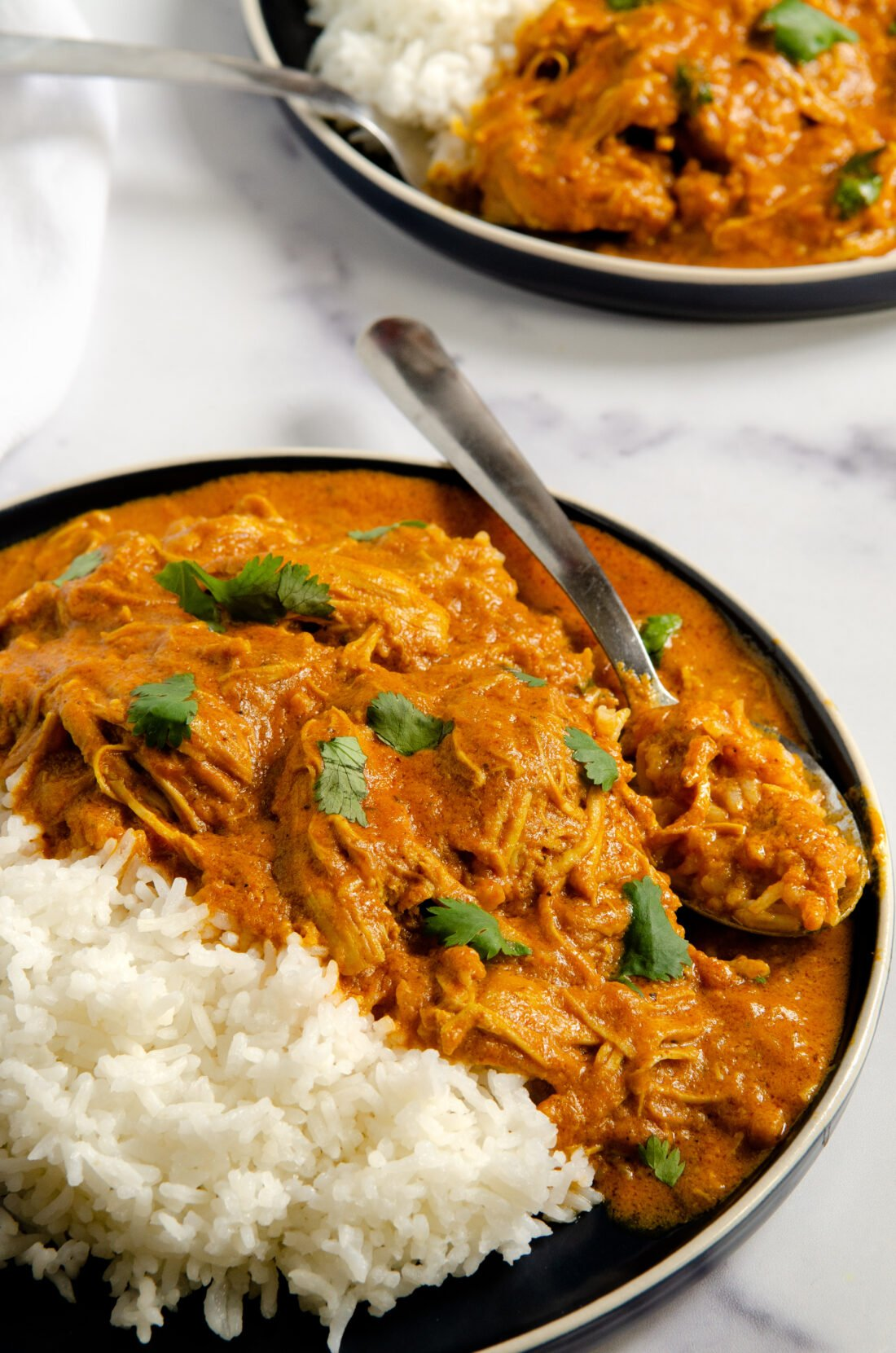 A quick and easy Indian Butter Chicken Recipe that's made in under 30 minutes. My Instant Pot Indian Butter Chicken is a buttery chicken that is smothered in a creamy tomato sauce. This flavorful dish is kid-approved and tastes even better as leftovers!