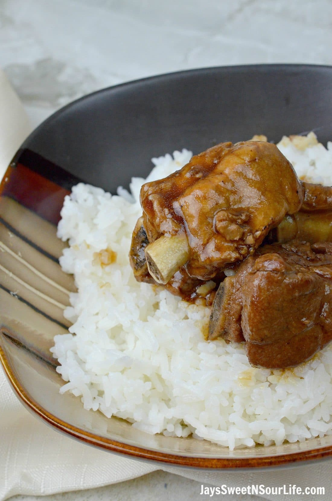 Instant Pot Filipino Pork Adobo Closeuin bowl. This fall of the bone Pressure Cooker Filipino Pork Adobo is to die for, try my families recipe and taste what we have been cooking for generations.