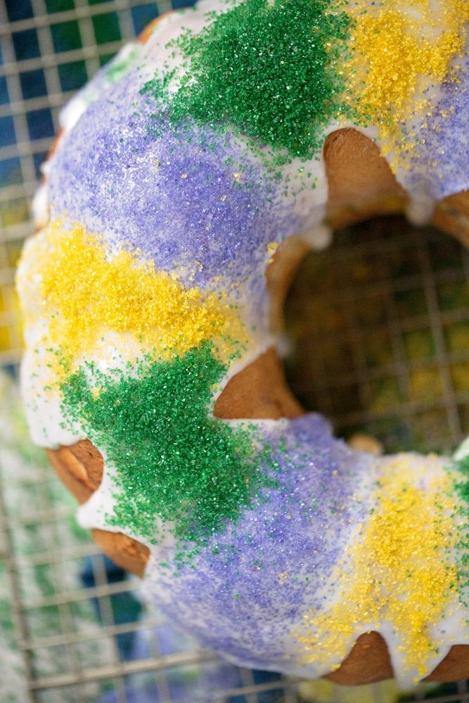 Mardi Gras King Cake Decoration. King Cake. Mardi Gras King Cake Filling. Celebrate Mardi Gras with this homemade Mardi Gras King Cake! A fun twist on the traditional King Cake, it's filled with a homemade strawberry filling. Bake and share this easy Strawberry Filled King Cake with your family.