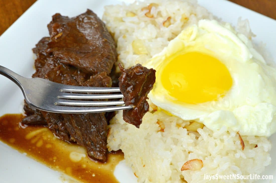 Instant Pot Filipino Beef Tapa Closeup On Fork. Instant Pot Filipino Beef Tapa is a traditional Filipino breakfast dish made inside a pressure cooker. It cuts like butter and is finger licking good.