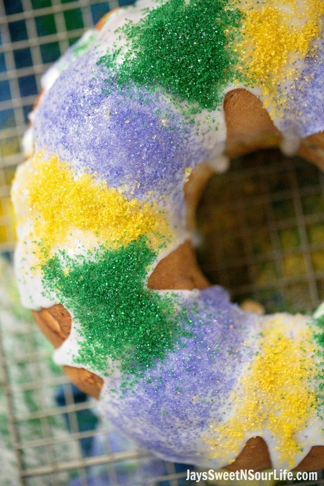 Mardi Gras King Cake Closeup. Hands down one of my absolute favorite cake recipes. Create a festive cake that the whole family will love. Check out the full recipe to see what secret ingredient I use in my recipe.
