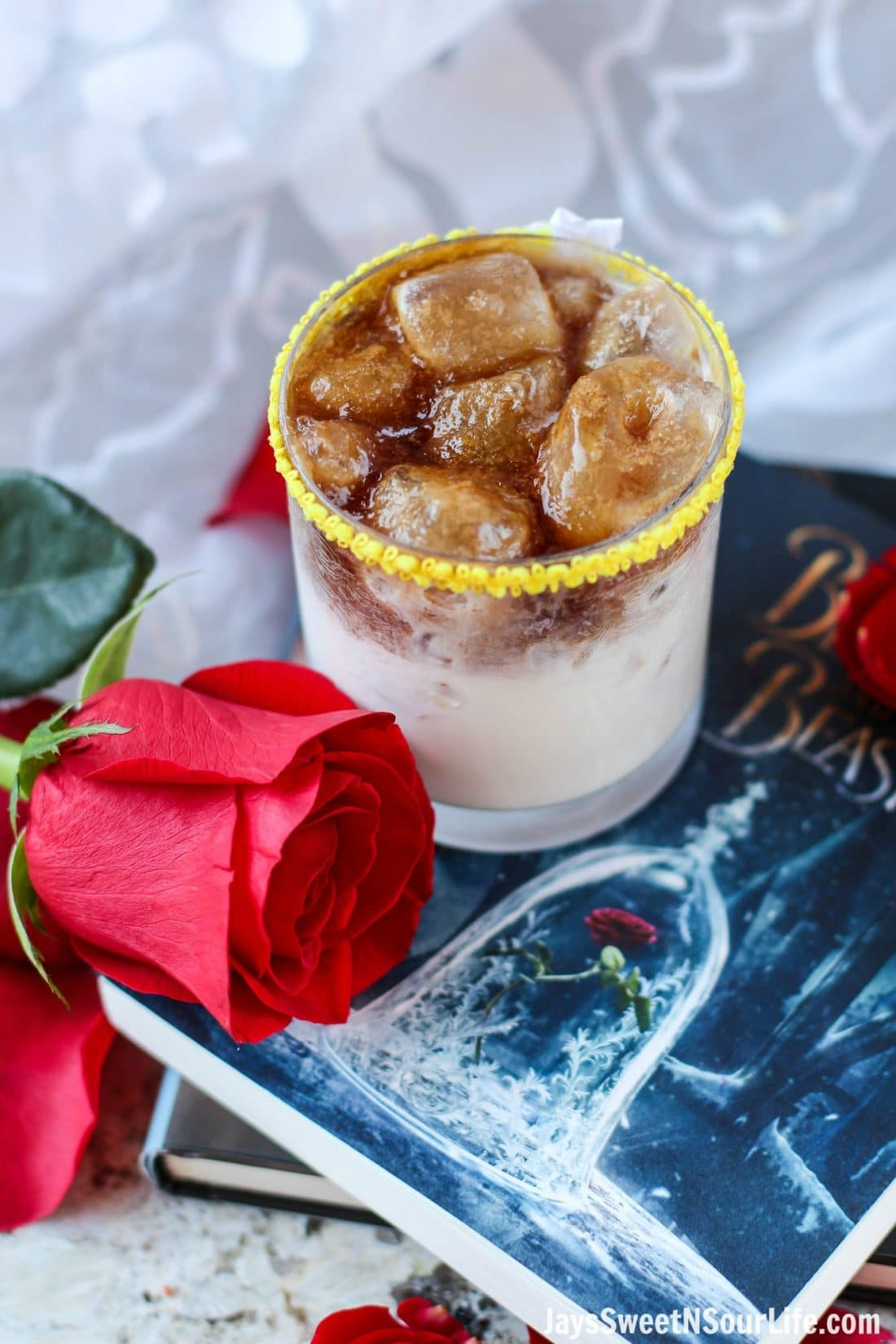 Beauty and the Beast Cocktail Rose. Break the curse with this Disney inspired Beauty and the Beast Cocktail. Made with layers of Kringle Cream Liqueur and Coffee Soda, this simple but elegant cocktail recipe delivers a delicious big flavor.