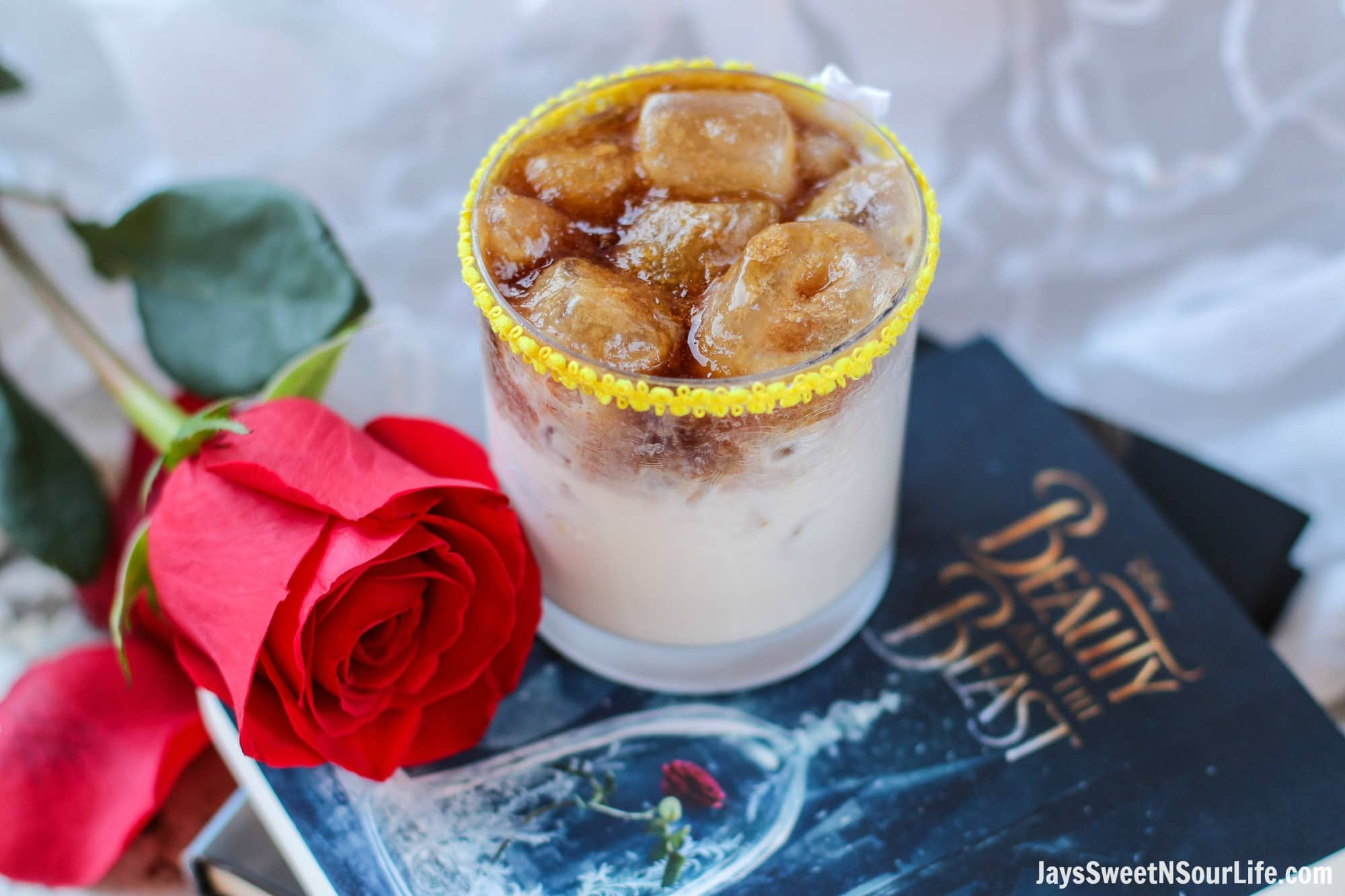 Easy Beauty and the Beast Cocktail. Break the curse with this Disney inspired Beauty and the Beast Cocktail. Made with layers of Kringle Cream Liqueur and Coffee Soda, this simple but elegant cocktail recipe delivers a delicious big flavor.