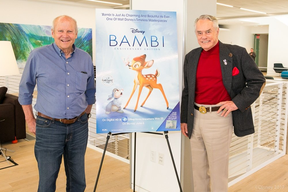 Donnie Dunagan and Peter Behn standing next to Bambi Movie Poster