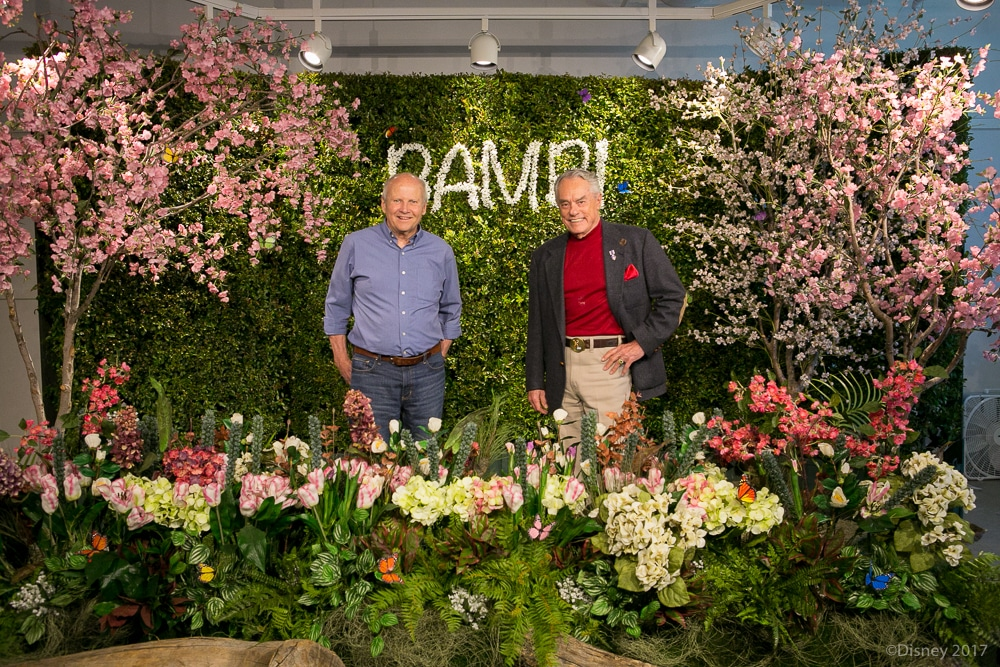 Peter Behn and Donnie Dunagan standing in group photo infront of Bambi themed backdrop during Interview With The Voices of Disney's Bambi and Thumper .