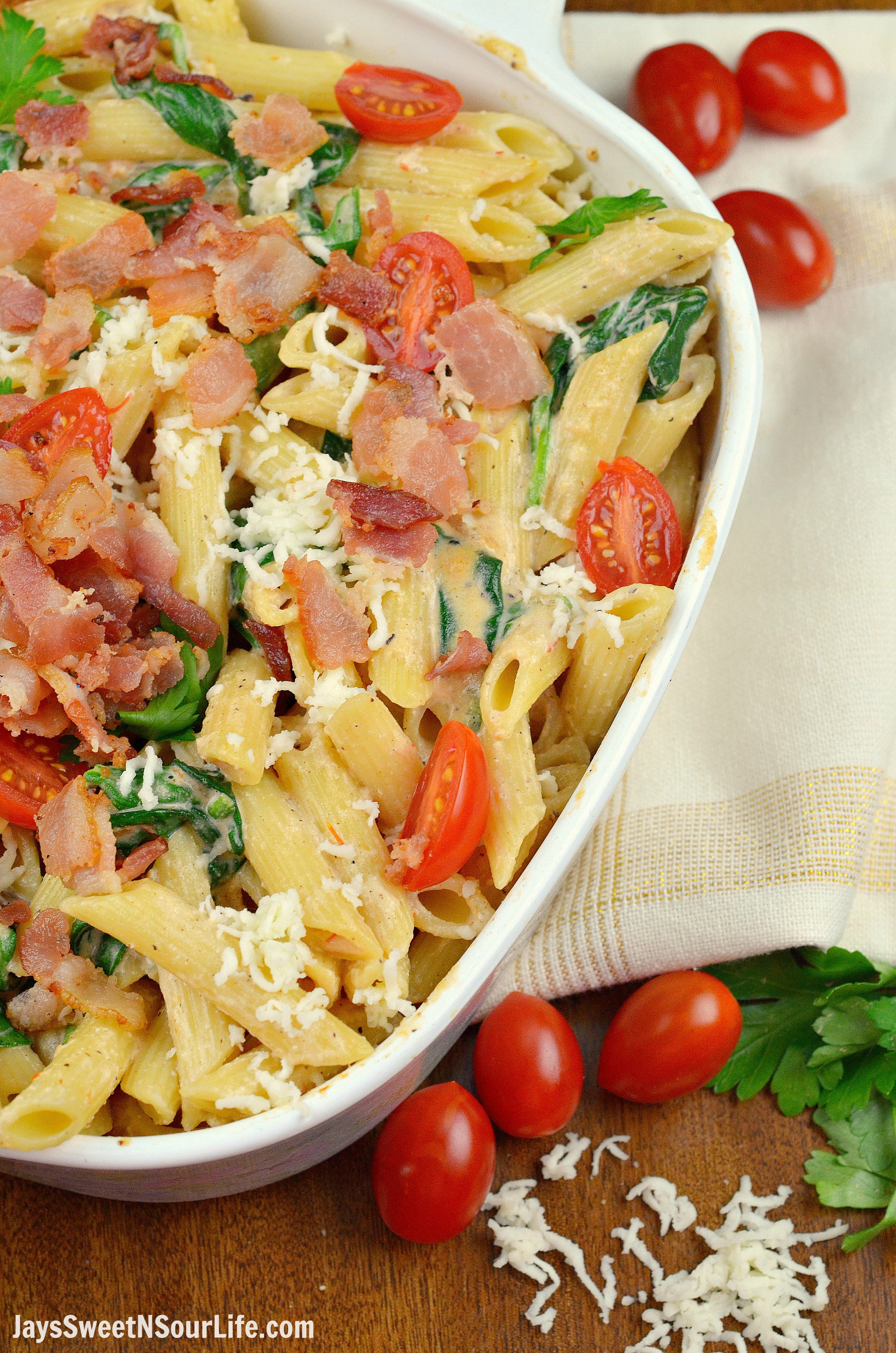 Cheesy Bacon and Spinach Penne Pasta in Pan. Treat your family this holiday season with a deliciously easy to make Cheesy Bacon and Spinach Penne Pasta. Perfect for any dinner time during the year. Shared via Jays Sweet N Sour Life.