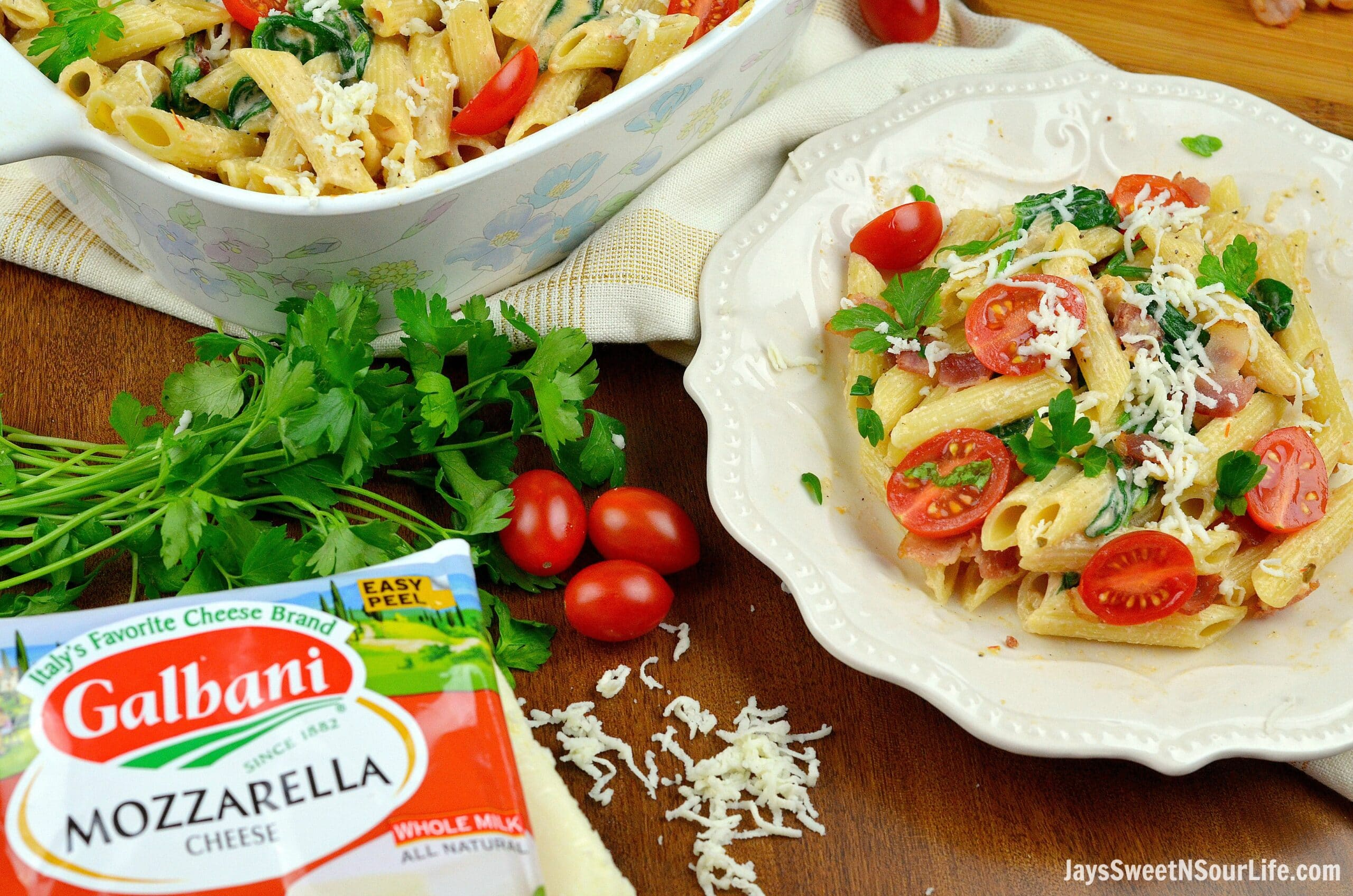 Cheesy Bacon and Spinach Penne Pasta Plated. Treat your family this holiday season with a deliciously easy to make Cheesy Bacon and Spinach Penne Pasta. Perfect for any dinner time during the year. Shared via Jays Sweet N Sour Life.