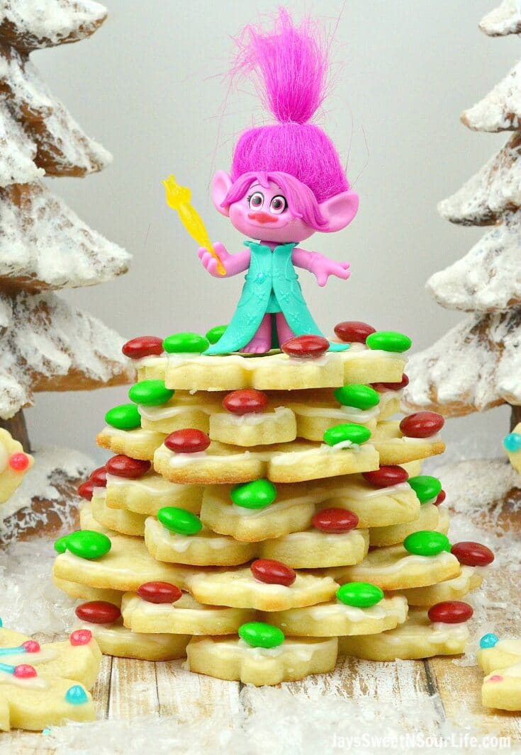 Trolls Holiday Tree Sugar Cookies Poppy. Bake, stack, and decorate these Trolls inspired Sugar Cookies. Decked out in fun Trolls Holiday themed colors, this fun Troll's Sugar Cookie Christmas Tree is a fun recipe and Christmas craft all in one!