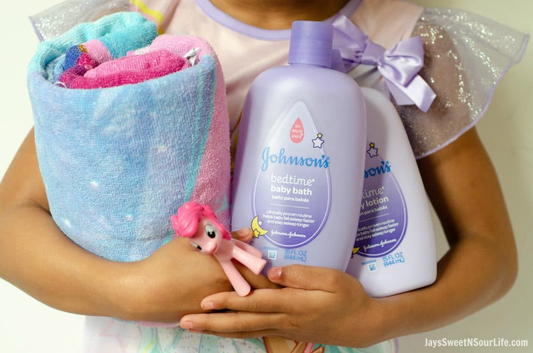 Create your very own Bathtime Travel kit with my checklist. Little african american girl holding her bathtime travel kit essentials.