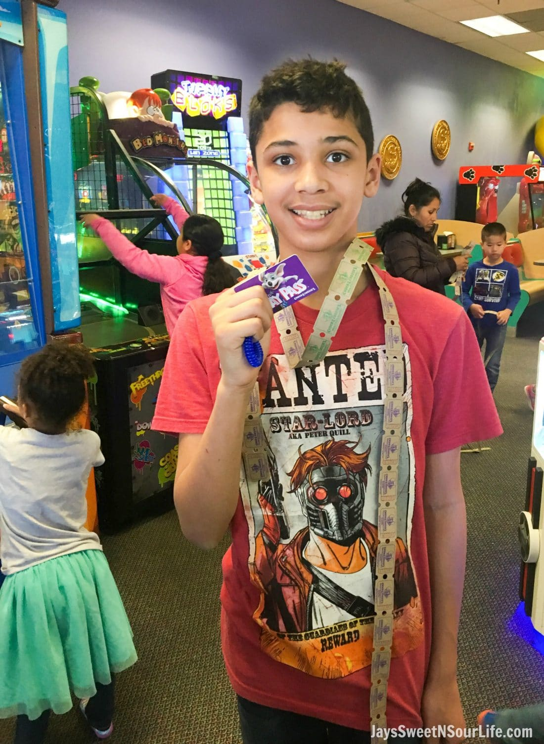 african american boy with tickets and play pass during Chuck e cheeses VIP birthday party. Book your party today and have guests enjoy 2 hours of unlimited game play.