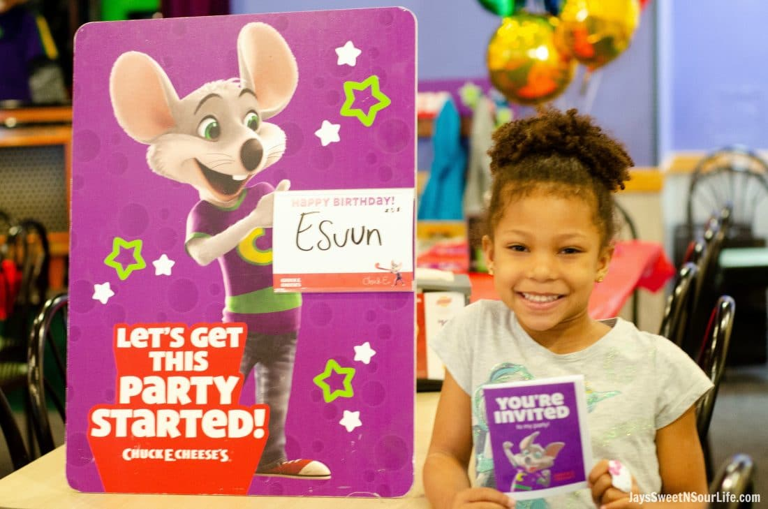 Chuck e cheeses VIP birthday party girl in front of sign with her name on it. Book your party today and have guests enjoy 2 hours of unlimited game play.