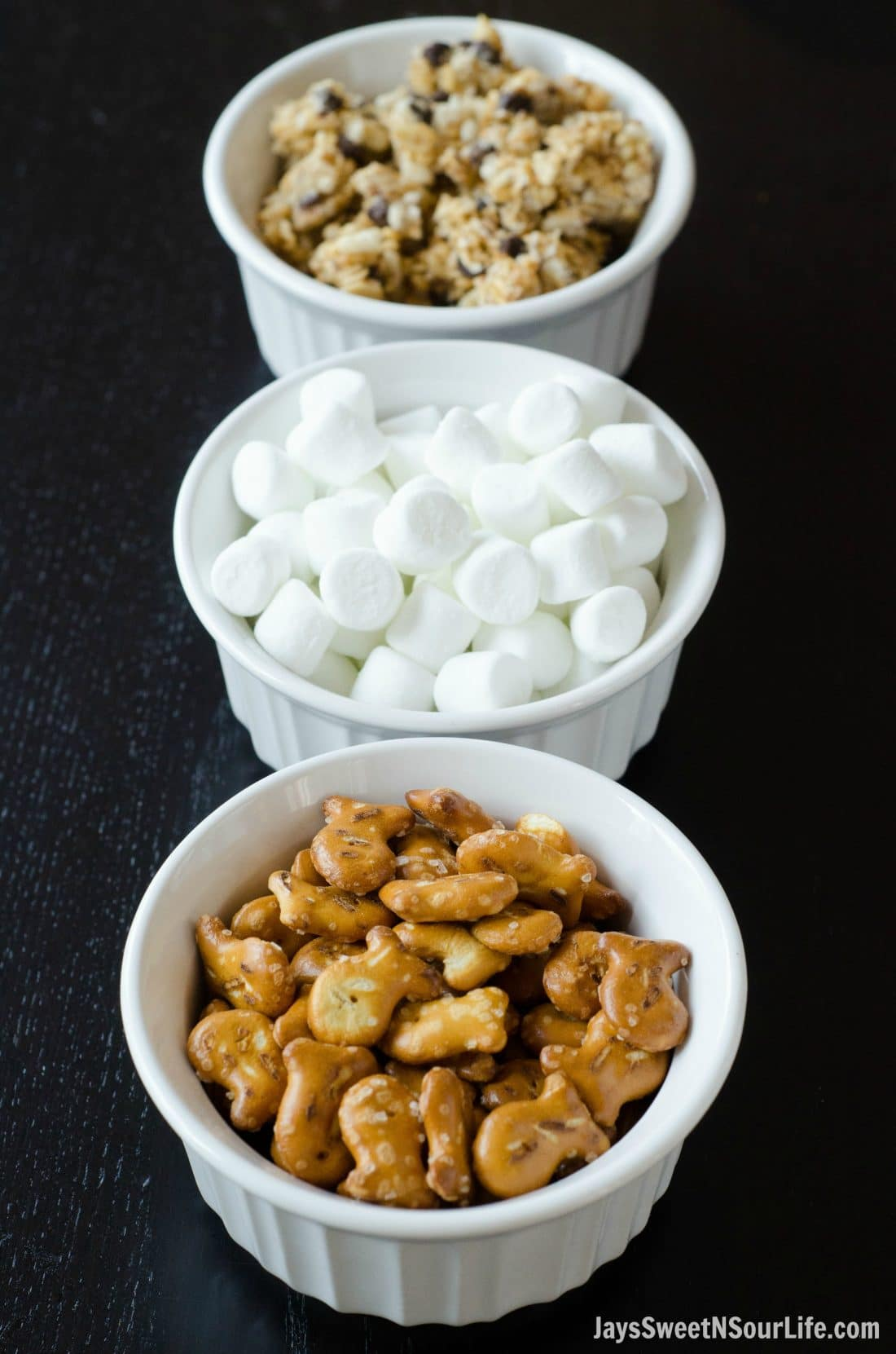 Mix something up so delicious even your kids will want to help make it. Start making your Goldfish Trail Mix with these 3 delicious ingredients, Marshmallows, goldfish pretzel crackers, and crumbled chocolatechip granola bars.