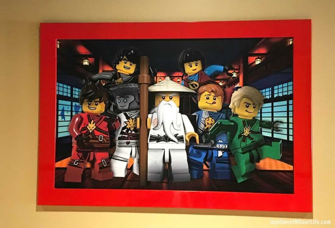 Legoland Florida Group Photo Poster inside of the Ninjago World Ride. Spend your summer building memories at Legoland in Florida. There is something for the whole family to enjoy at this wonderful Theme Park.