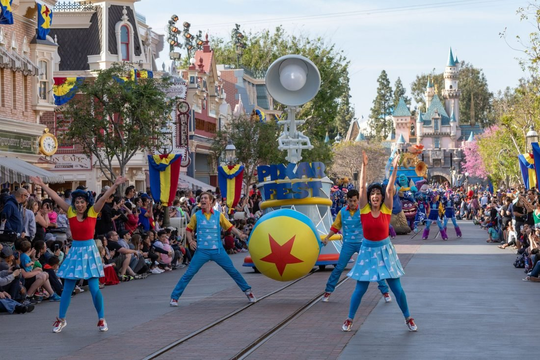 Pixar Play Parade shot of the cast performing. Pixar Fest brings lot sof fun parades and food for guests to enjoy.