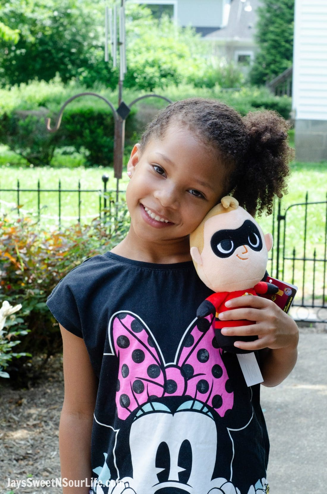African American Girl holding Incredibles Mr Incredible Plush Doll. New Disney Pixars Incredibles 2 Toys + More | Incredibles 2 Gift Guide