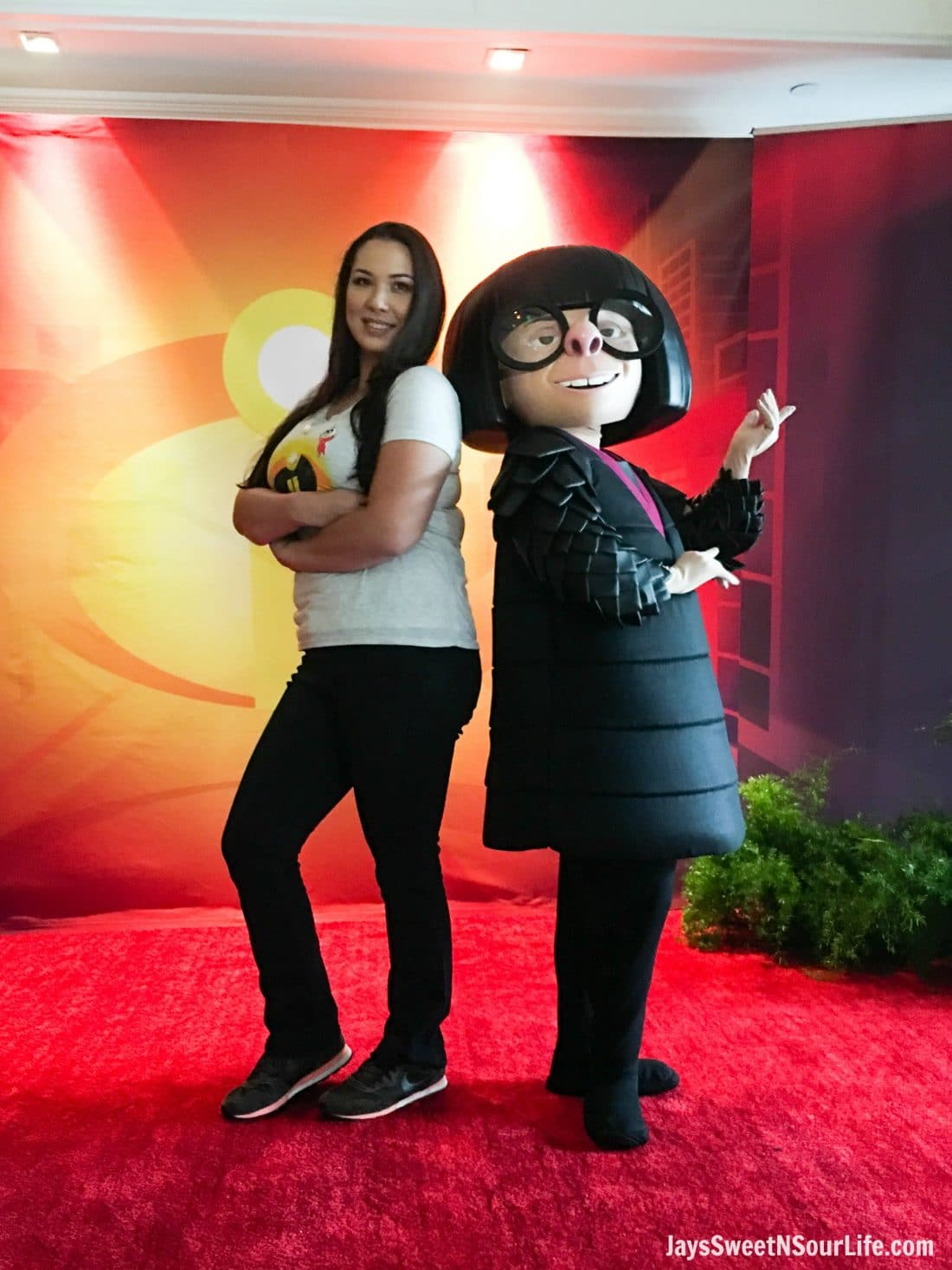 Filipino Woman Posing with Edna Mode from Incredibles 2 Press Junnket. The Incredibles 2 film will be in theaters everywhere June 15th.