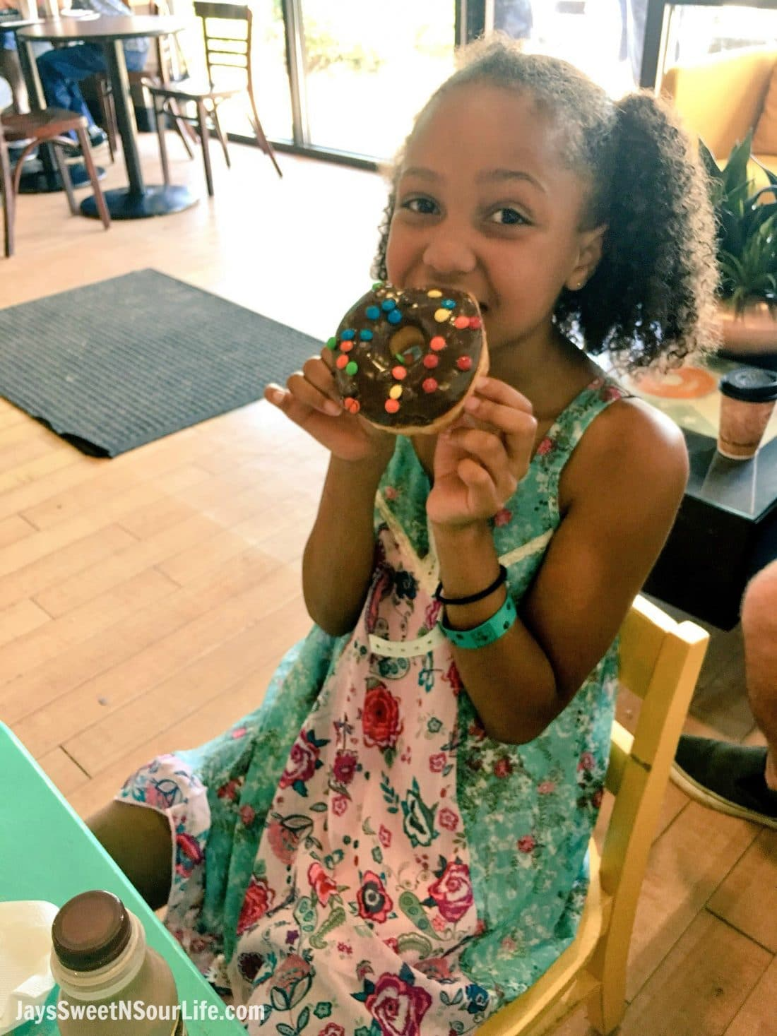 OMG Donuts and Bakery - Visit Cabarrus County Girl eating donut.A Large Families Adventure Guide To Cabarrus County - North Carolina - via JaysSweetNSourLife.com.