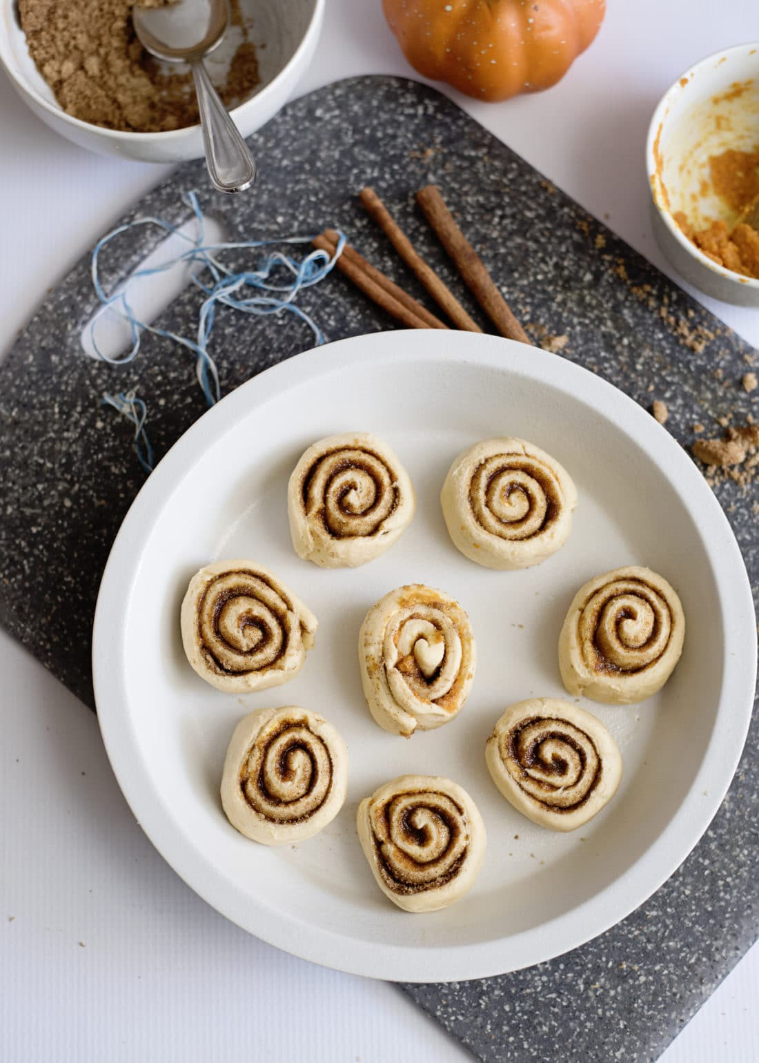 Pumpkin Spice Cinnamon Rolls In Pan.Fill your home with the delicious smell of these easy to make Pumpkin Spice Cinnamon Rolls.
