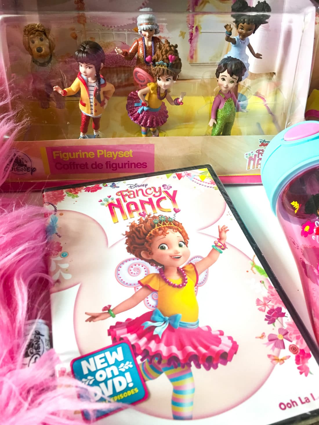 """Disney Junior Fancy Nancy DVD and Figure Set. Grab some glitter, add a dash of """"ooh la la,"""" sprinkle in original songs and Voilà! Get set to pour on the fun with Fancy Nancy in her newest DVD from Disney Junior."""