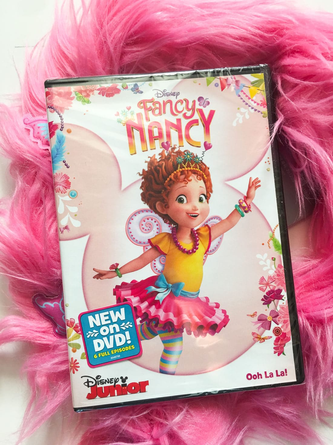 """Disney Junior Fancy Nancy DVD. Grab some glitter, add a dash of """"ooh la la,"""" sprinkle in original songs and Voilà! Get set to pour on the fun with Fancy Nancy in her newest DVD from Disney Junior."""
