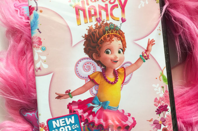 "Disney Junior Fancy Nancy DVD. Grab some glitter, add a dash of ""ooh la la,"" sprinkle in original songs and Voilà! Get set to pour on the fun with Fancy Nancy in her newest DVD from Disney Junior."