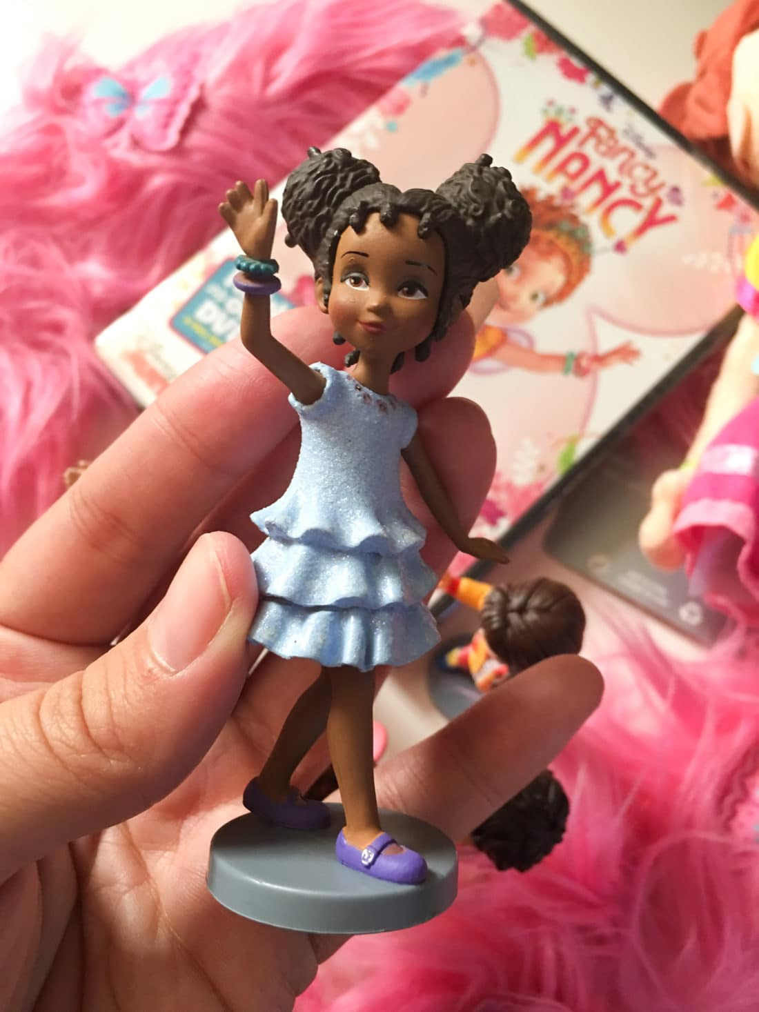 """Fancy Nancy Figure Set Bree. Grab some glitter, add a dash of """"ooh la la,"""" sprinkle in original songs and Voilà! Get set to pour on the fun with Fancy Nancy in her newest DVD from Disney Junior."""